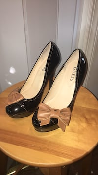 pair of black leather peep-toe pumps