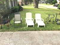 four white and one green plastic armchairs 1210 mi