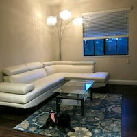 White couch with table and lamp  Plantation, 33313