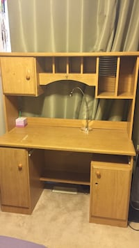 Brown wooden desk with hutch