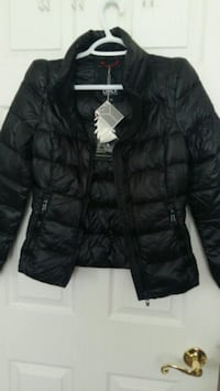 Small Light jacket with pouch. Brand new.  Toronto, M1E 3T1