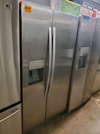 Whirlpool side by side Doors fridge stainless Steel working perfectly  Baltimore, 21223