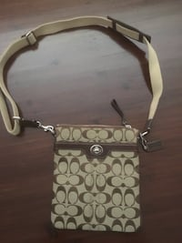 Brown canvas and leather Coach sling bag. Ottawa, K4A 2P8