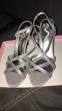 Pair of gray open-toe ankle strap heels 251 mi
