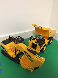 Two yellow-and-black caterpillar toy trucks Barrie, L4N 5M4