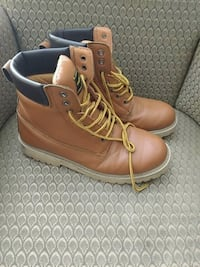 pair of brown leather work boots Vancouver