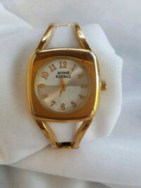 round gold-colored analog watch with link bracelet Renton