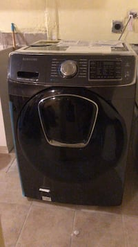 black Samsung front-load clothes washer New York, 10031