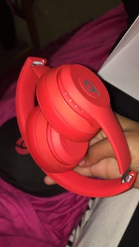 red Beats by Dr. Dre wireless headphone