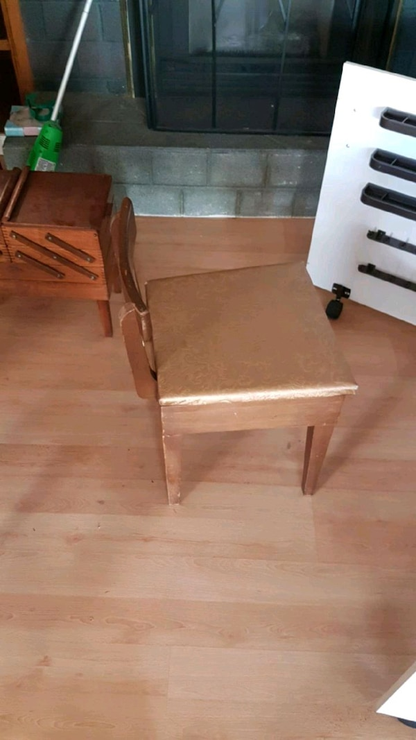 Antique sewing chair with hidden storage space.