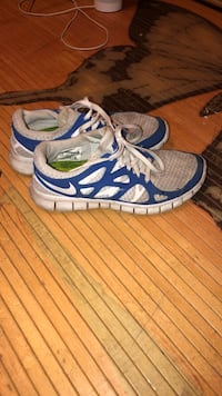pair of blue-and-white Nike running shoes Bakersfield, 93306