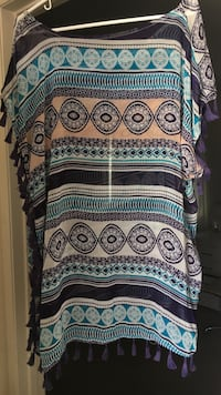 Women's blue, white, and black floral swim suit coverup