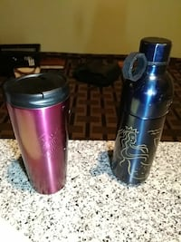 two black and purple tumblers
