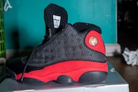 Unpaired red and black air jordan 13 shoe size 8 409 mi