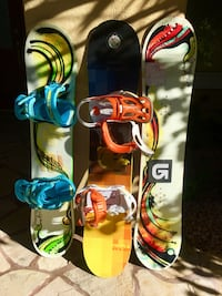 yellow and blue snowboard with bindings 2056 mi