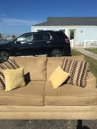 wheat colored loveseat- excellent condition