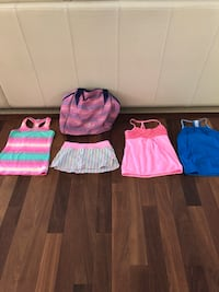 Iviva tops and 1 pair of shorts. All items are size 10-12. Edmonton, T6J 1X3