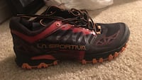 unpaired black and pink LA Sportiva sneaker