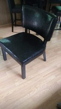 black leather padded wooden chair null