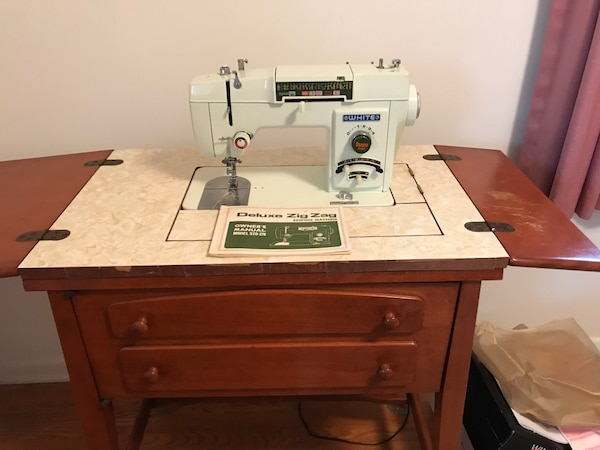 White Sewing Machine and Cabinet, with manual, box of accessories. May need tension adjustment. Asking $40. Pick up only in Emmaus.