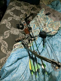 brown and black compound bow 210 mi
