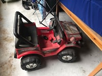 toddler's red and black ride-on toy Westmount, H3Z 1M2
