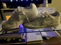 pair of gray Nike running shoes Hamilton