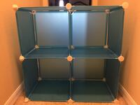 4 cubby holder. They are blue and plastic   Newberry, 32669