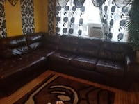 brown leather sectional couch with ottoman Toronto, M6H 1Y4