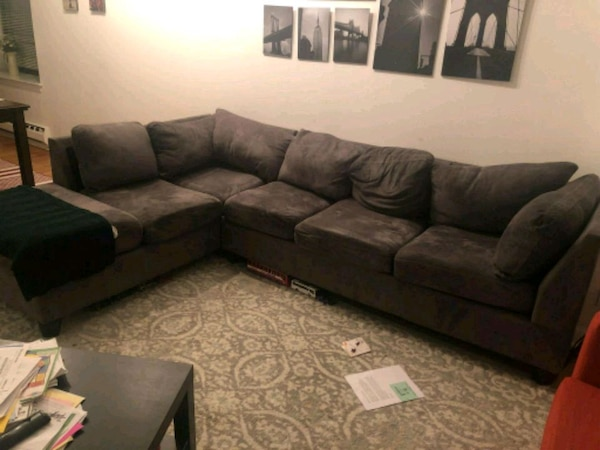 Used black suede sectional sofa with throw pillows for sale ...