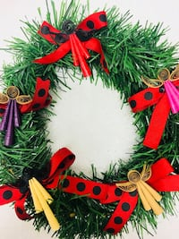 green and red ribbon and grass door wreath