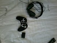black corded headphones and black wireless game co