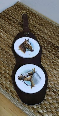 Pair of Horse Plaques on Leather wall hanging