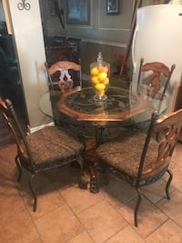 round brown wooden table with four chairs dining set Lafayette, 70507