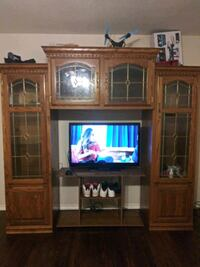 brown wooden TV hutch with flat screen television Dallas, 75216