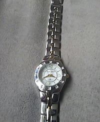 round analog watch with silver link band Winnipeg, R2V 0Y2