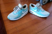 pair of blue Nike running shoes Los Angeles, 91325
