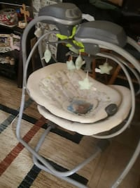 white and gray cradle n swing null