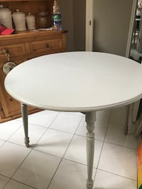 round white wooden table with gray metal base Surrey, V4P 1C6