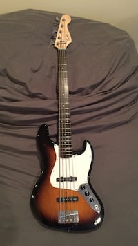 brown and black 5-string electric bass guitar