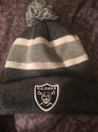 grey and white Oakland Raiders bobble hat