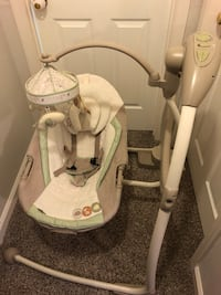 Baby swing. Music and timer setting. Swings on a magnet and has optional seat and swaying positions. Safety buckle and head pillows. Battery powered or wall plug options Alexandria, 22306