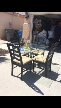 black metal framed glass top table with chairs Palmdale, 93550