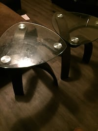 round clear glass-top table with brown wooden base Houston, 77042