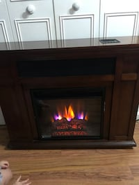 brown wooden framed electric fireplace Sterling, 20164