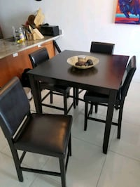 High top table and 4 leather back chairs