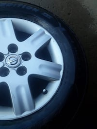 Set pair 4 Nissan wheels w tires Nashville