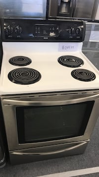 white and black Kenmore electric coil range oven