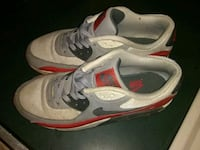 gray-and-red Nike running shoes Liberty, 27298