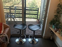 Two stainless steel swivel chairs/ bar stools